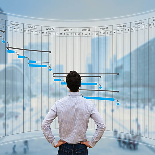 Man looking at graphs on large virtual screen