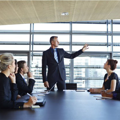 Man pointing while in a board meeting