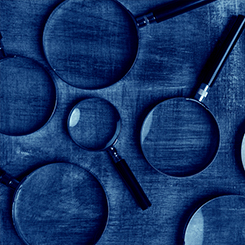 Magnifying glasses on blue background