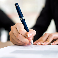 Hands with pen